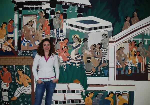 Artist with Ajanta Wall Mural.